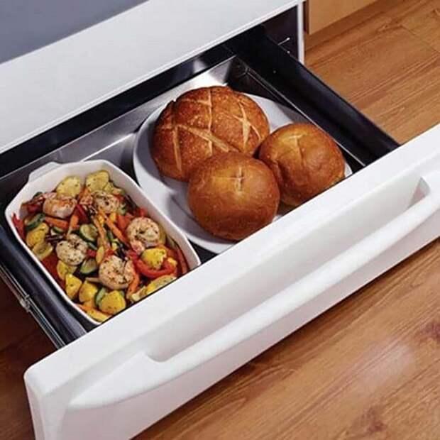 В ящике под духовкой временно хранятся готовые блюда. / Фото: dratyti.info