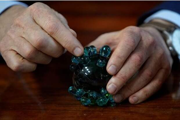 Alexander Gintsburg, director of the Gamaleya National Research Center for Epidemiology and Microbiology, holds a crystal coronavirus figure during an interview with Reuters in Moscow, Russia September 24, 2020. Picture taken September 24, 2020. REUTERS/Tatyana Makeyeva