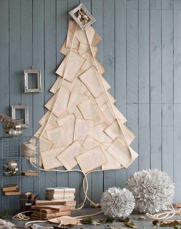 Оформление стены с помощью книжных листов, что станет оригинальным новогодним украшением.