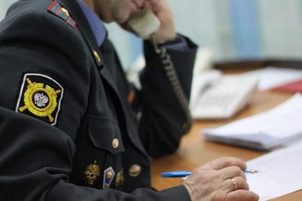 В Томске полицейский, грубо задержавший мигранта в УФМС, получил предупреждение