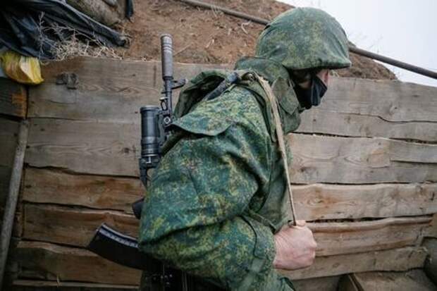 A militant of the separatist Donetsk People's Republic is seen at frontline positions located on the troops contact line with Ukrainian forces near the village of Leninsko in Donetsk Region, Ukraine December 18, 2020. REUTERS/Alexander Ermochenko