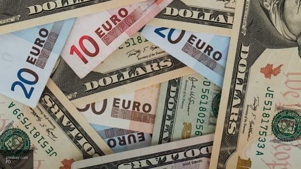 ЦБ снизил официальные курсы доллара и евро на 12–14 сентября