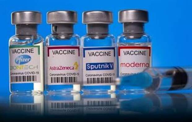 Vials with Pfizer-BioNTech, AstraZeneca, Sputnik V, and Moderna coronavirus disease (COVID-19) vaccine labels are seen in this illustration picture taken March 19, 2021. REUTERS/Dado Ruvic/Illustration