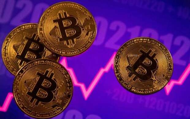 FILE PHOTO: A representation of virtual currency Bitcoin is seen in front of a stock graph in this illustration taken March 15, 2021. REUTERS/Dado Ruvic