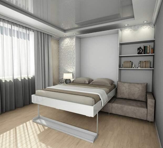 В разложенном виде - это кровать, в сложенном - фасад с полками, а спереди диван. / Фото: severdv.ru
