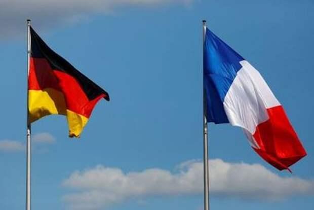 Флаги Германии и Франции в Берлине, Германия, 15 мая 2017 г. REUTERS/Pawel Kopczynski