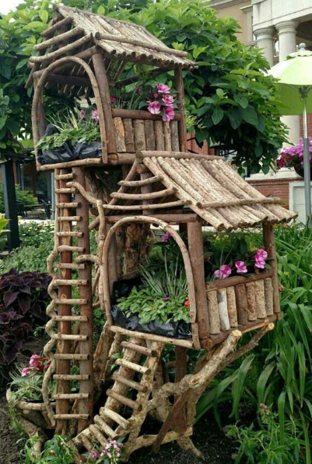 Декоративные цветочные домики. | Фото: ZYHOMY.