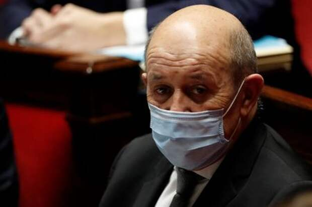 French Foreign Minister Jean Yves Le Drian, wearing a protective face mask, attends the questions to the government session at the National Assembly in Paris amid the coronavirus disease (COVID-19) outbreak in France, January 26, 2021. REUTERS/Gonzalo Fuentes