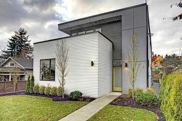 Дом современной архитектуры, обшитый фиброцементными плитами. Фото с сайта hepcawareub2.info