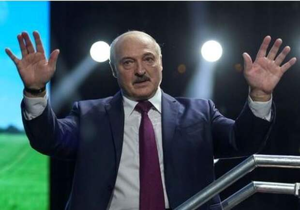 Belarusian President Alexander Lukashenko waves to his supporters at the forum of Union of Women in Minsk, Belarus September 17, 2020. Tut.By via REUTERS