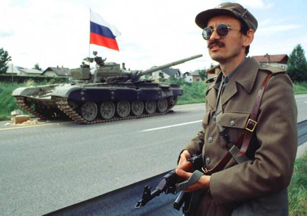 Ten-day war (Slovenian Independence War), 29th of June 1991, Vrhnika, Slovenia. Slovenian Soldier and a seized tank of JLA (Yugoslavian National Army).jpg