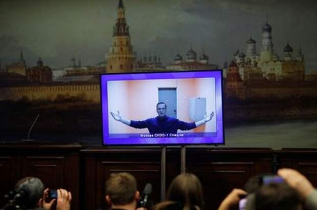 Russian opposition leader Alexei Navalny is seen on a screen via a video link during a court hearing to consider an appeal on his arrest, outside Moscow, Russia January 28, 2021. REUTERS/Maxim Shemetov