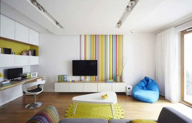Modern living room with colorful striped wall decor