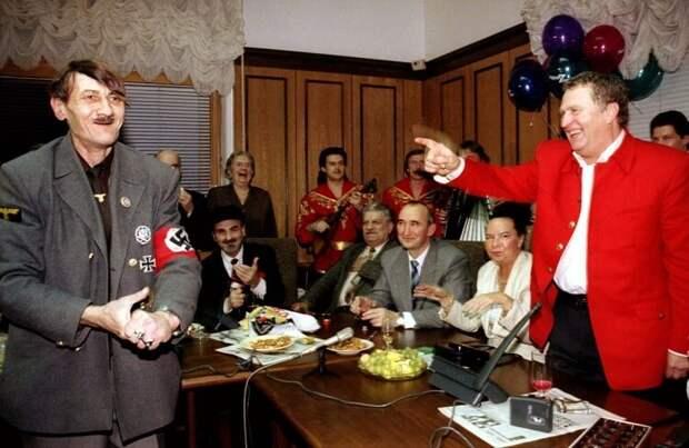 Russian ultranationalist leader Vladimir Zhirinovsky (R) points at a look-alike of Adolf Hitler duri..