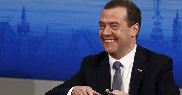 Russian Prime Minister Medvedev smiles as he attends at the Munich Security Conference in Munich