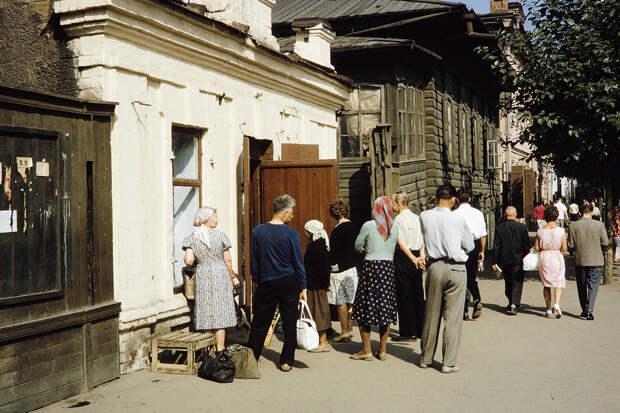 Russia, people standing in line at Irkutsk shop for milk