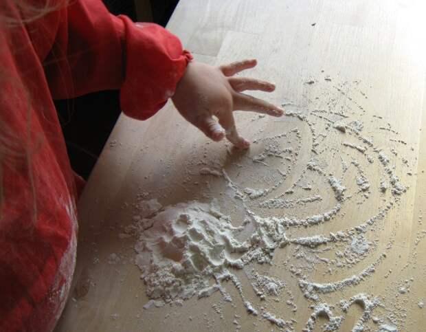http://raisingsparks.com/wp-content/uploads/2011/05/drawing-in-flour.jpg