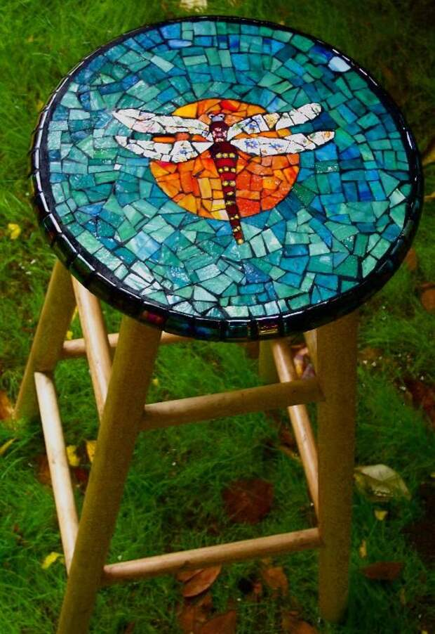 Dragonfly mosaic stool.  But I think this would look better as a small round table top.