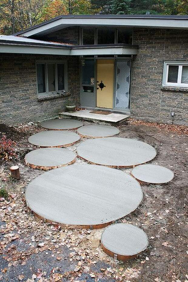 Large and small mod look concrete circle stepping stones for the backyard