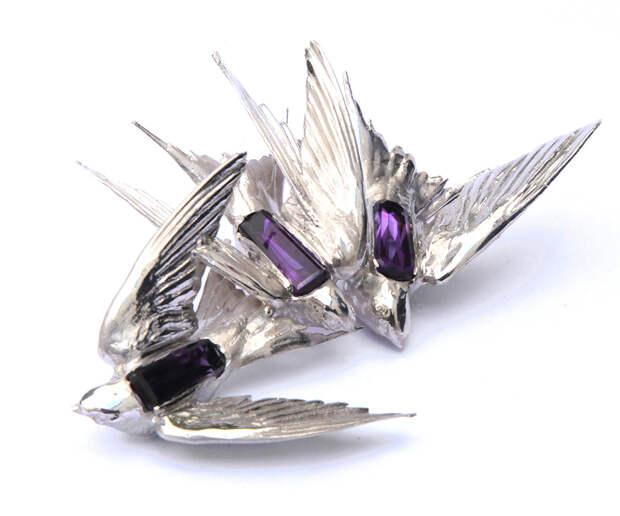 Jordan Askill Intercepted Swallows brooch with a