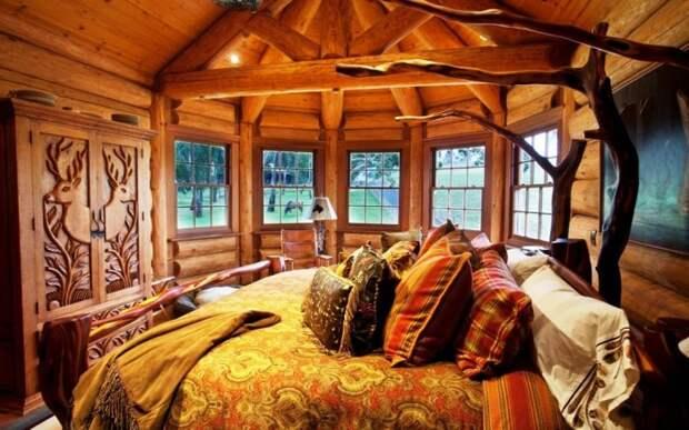 Интерьер в деревенском стиле из натурального дерева – идеальное жилье для тельцов.   Фото: burosneg.ru.