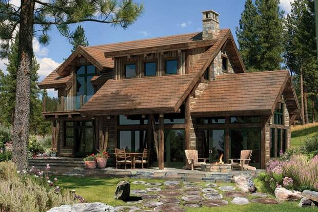 Современное воплощение деревянного дома для большой семьи или небольшого загородного отеля.