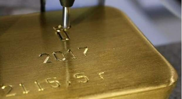 A machine engraves information on an ingot of 99.99% pure gold at the Krastsvetmet non-ferrous metals plant in the Siberian city of Krasnoyarsk, Russia September 22, 2017. REUTERS/Ilya Naymushin/File Photo