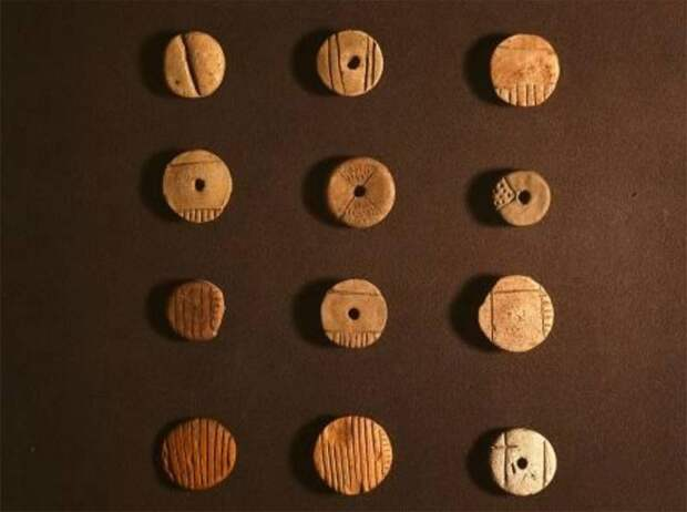 Disk tokens from Uruk, ca. 3300 BC
