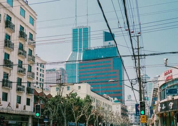 В Китае обрушился 7-этажный дом. Погибли пять человек (Видео)