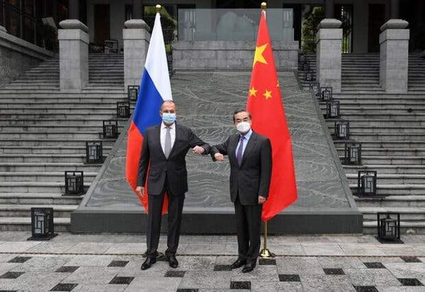 """Sergey V. Lavrov, left, and Wang Yi, the Russian and Chinese foreign ministers, in Guilin, China, last week. They urged the United States to""""reflect on the damage it has done."""""""