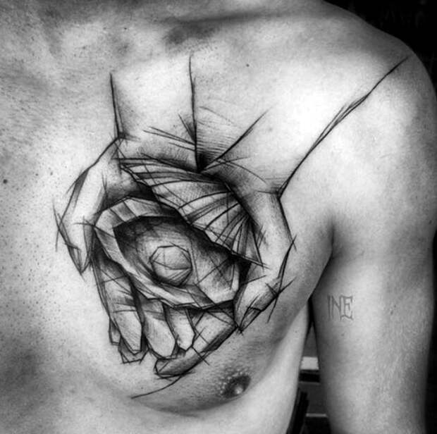 Татуировка в стиле скетч на мужской груди.