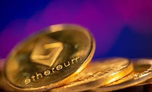FILE PHOTO: A representation of virtual currency Ethereum are seen in front of a stock graph in this illustration taken February 19, 2021. REUTERS/Dado Ruvic/Illustration/File Photo