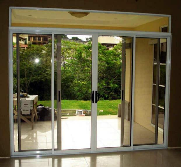 Дом со стеклянными дверями.   Фото: Гласстрой.