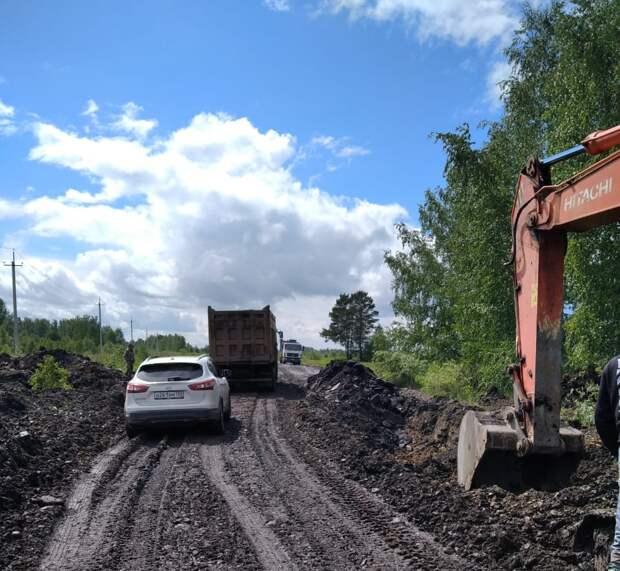На восстановлении размытой дороги Качуг – Жигалово работают 13 единиц техники