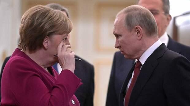 Негодование в Киеве: Путин и Меркель договорились давить Украину